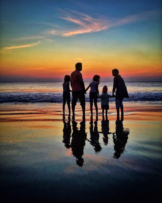 Twilight at the beach EyeEm Gallery Eye4photography  Popular Photos Beach India Sunset_collection Sunset Silhouettes Sun_collection Silhouette Showcase: January Enjoying Life Water Reflections IPhoneography IPS2016Composition Silhouette Beach Reflection Sea People Family At The Beach Sunset #sun #clouds #skylovers #sky #nature #beautifulinnature #naturalbeauty #photography #landscape Sunset