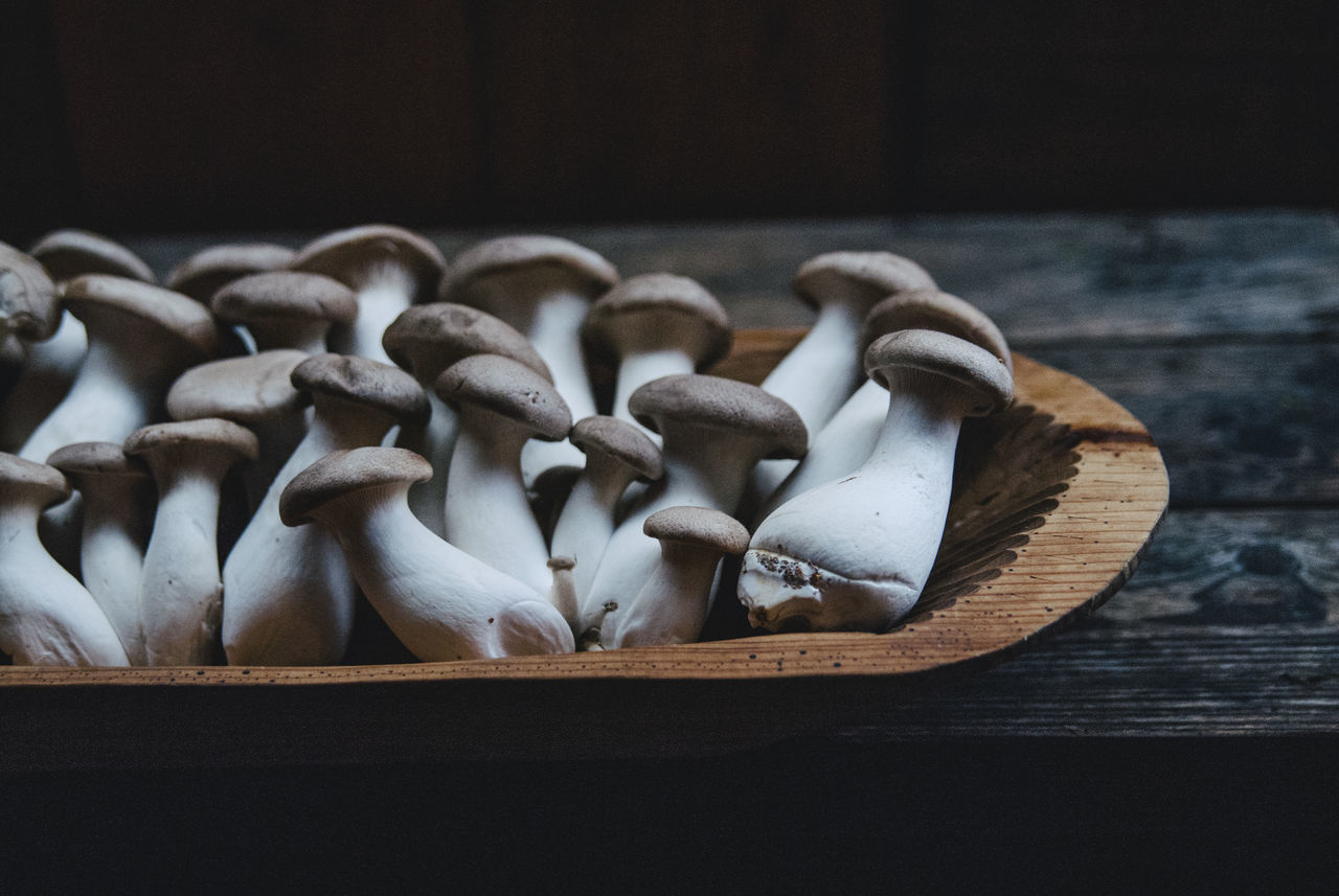 Close-Up Of Edible Mushrooms In Tray On Table