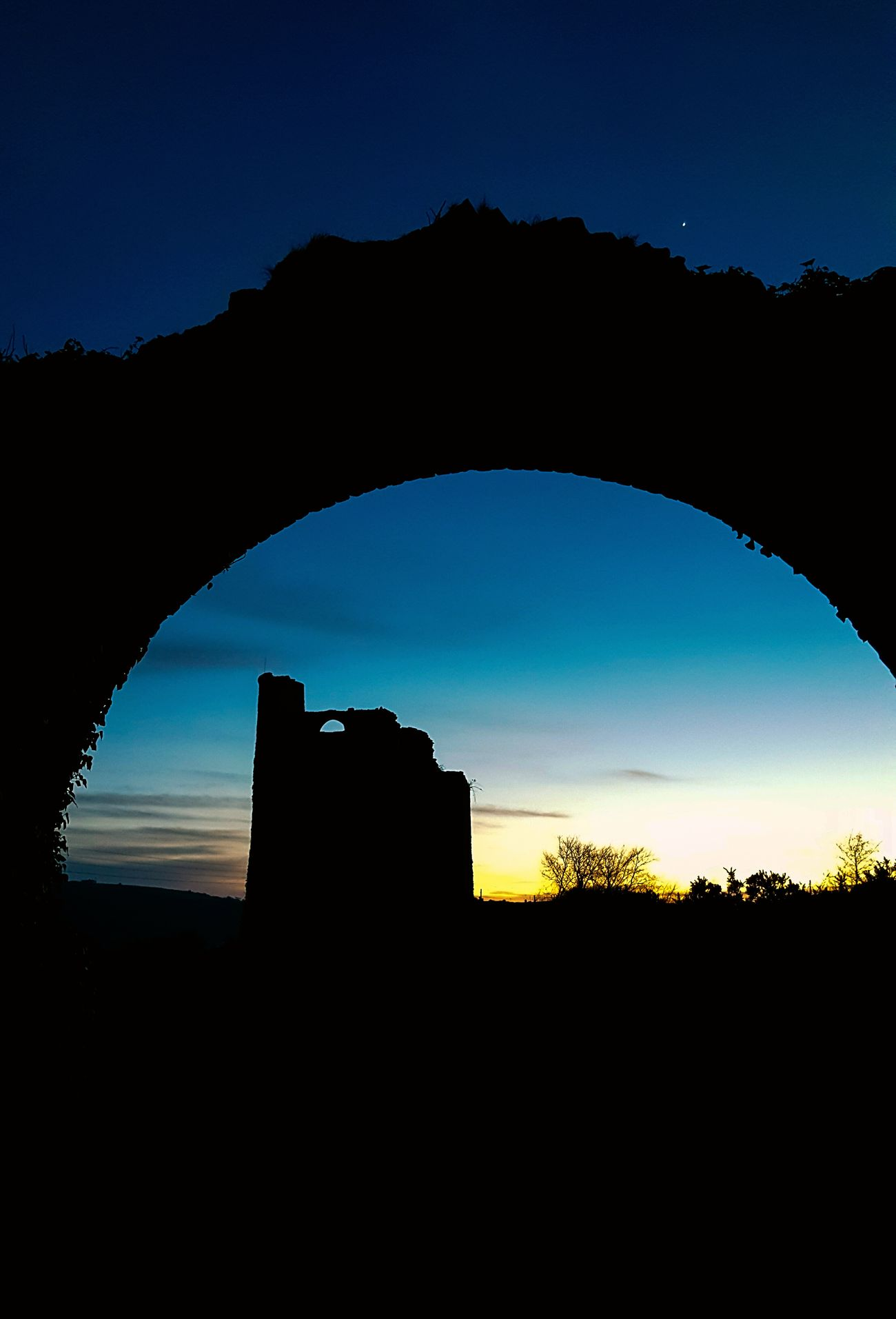 Siluette Stone Archway History Architecture Silhouette Sky Built Structure Old Ruin Sunset Arch Outdoors No People Scenics Multi Colored Sillouettes Sillouettes And Sunsets Silhouette_collection Sillhouttes And Sky Sunlight Sunset_collection Sunsets Dark Stone Structure Mining Industry Mining Heritage Mining Site Mining Village Mineshaft Tinmines Landscape Landscapes Evening Carn Brea Carnbrea Cornwall
