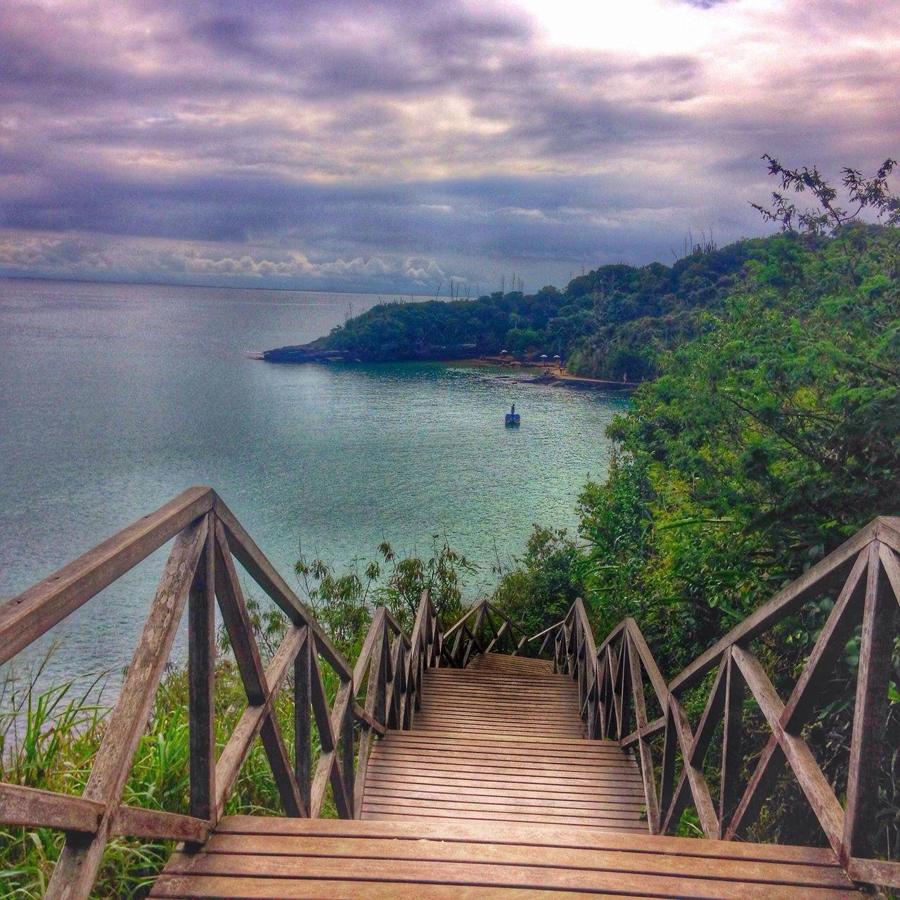 water, sea, railing, sky, nature, cloud - sky, scenics, beauty in nature, tranquil scene, jetty, tranquility, mountain, outdoors, travel destinations, tree, day, vacations, nautical vessel, no people