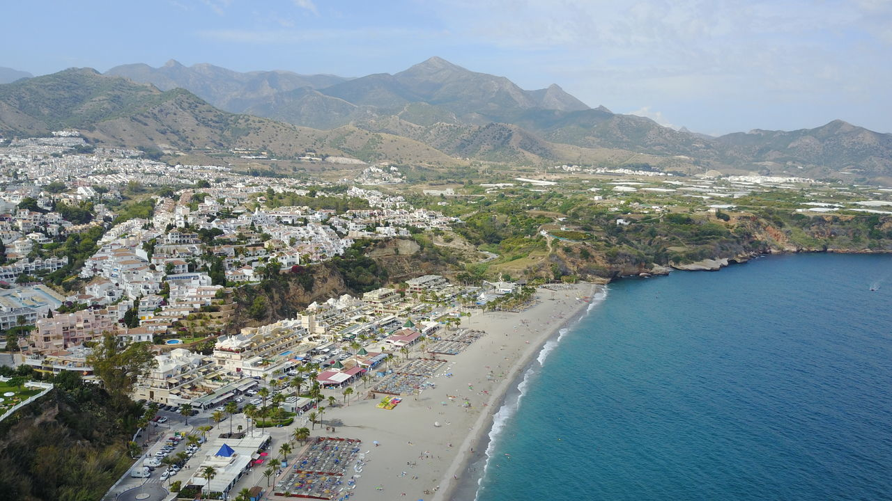 Aerial Shot Beach View Cityscape Travel Destinations Mountains Ocean Spain Andalusia Nerja Coast Scenics Water Beach Travel Vacations Sand Waves Beauty In Nature Sky Mountain Range High Angle View Travel Photography Summer Nerja Costa Tropical Live For The Story Andalusia