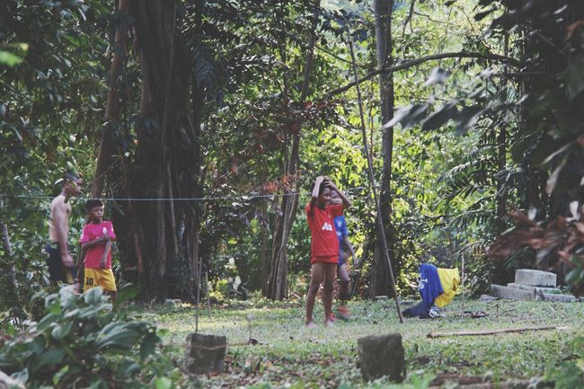 Boys Plaing football Cemetery in Kuala Lumpur Malaysia  South East Asia Outdoor People Telling Stories Differently Showcase July