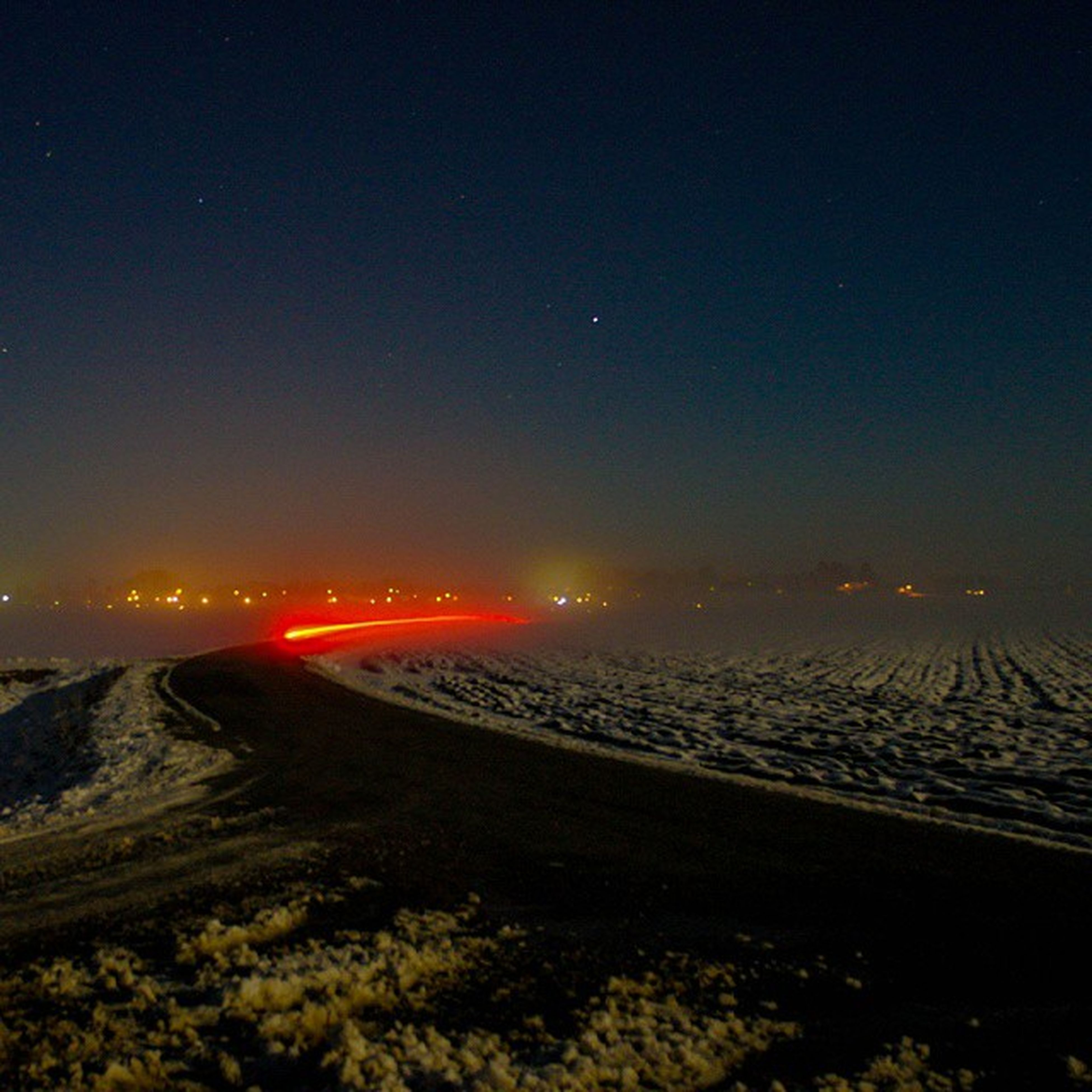 scenics, tranquil scene, night, illuminated, tranquility, landscape, beauty in nature, nature, sky, sunset, mountain, idyllic, copy space, clear sky, snow, winter, transportation, non-urban scene, road, outdoors