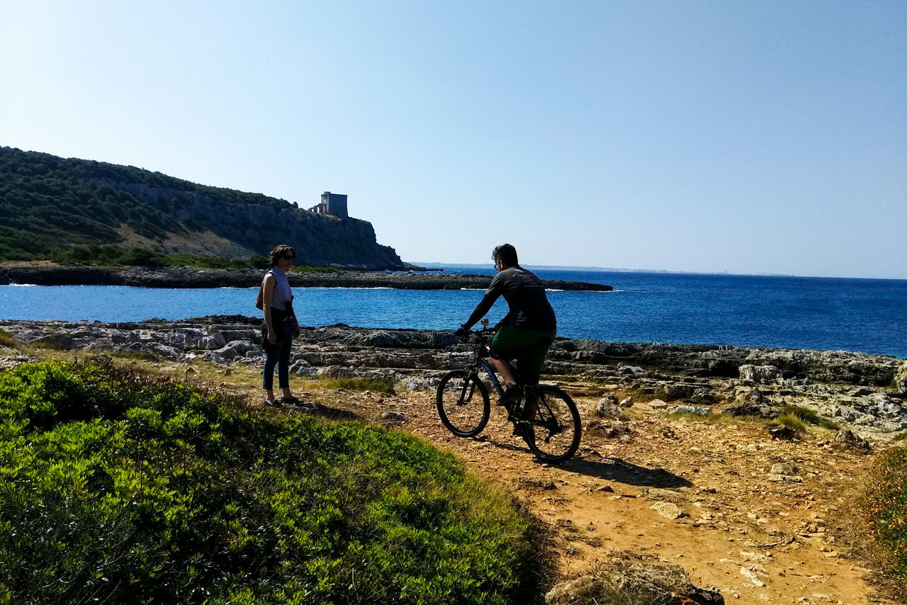 Bicycle Water Cycling Sky Transportation Sea Day Nature Outdoors Men People Togetherness Headwear Adult Clear Sky Real People Mountain Bike Beauty In Nature Only Men Adults Only Porto Selvaggio Salento Porto Selvaggio Nardo Lecce Italy