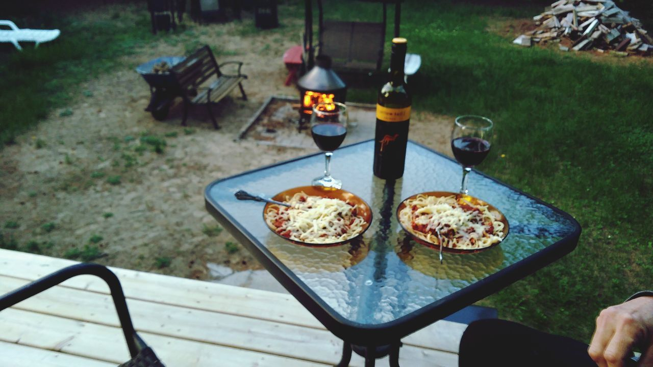 food and drink, table, bottle, food, high angle view, drink, alcohol, day, freshness, no people, outdoors, wineglass, ready-to-eat, close-up