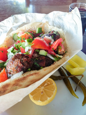 Close Up Close-up Cucumber Cypriot Day Delicious Food Food And Drink Freshness Lemon Meat Mediterranean Diet No People Paper Pita Bread Sausage Sheftalia Street Food Tomatoes Wrapped Yummy