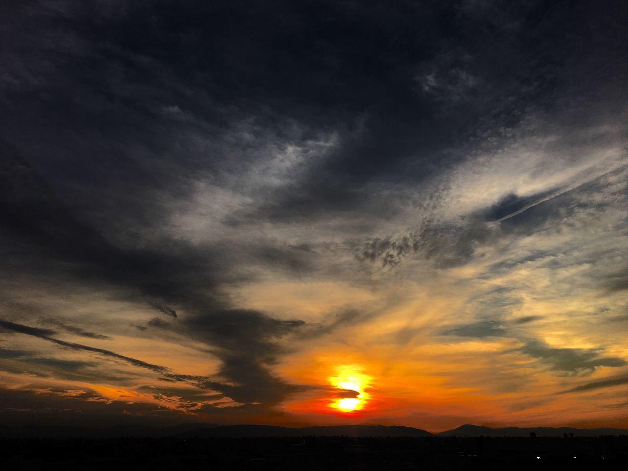 sunset, orange color, beauty in nature, nature, scenics, dramatic sky, tranquility, sky, tranquil scene, majestic, cloud - sky, silhouette, sun, idyllic, no people, outdoors, landscape