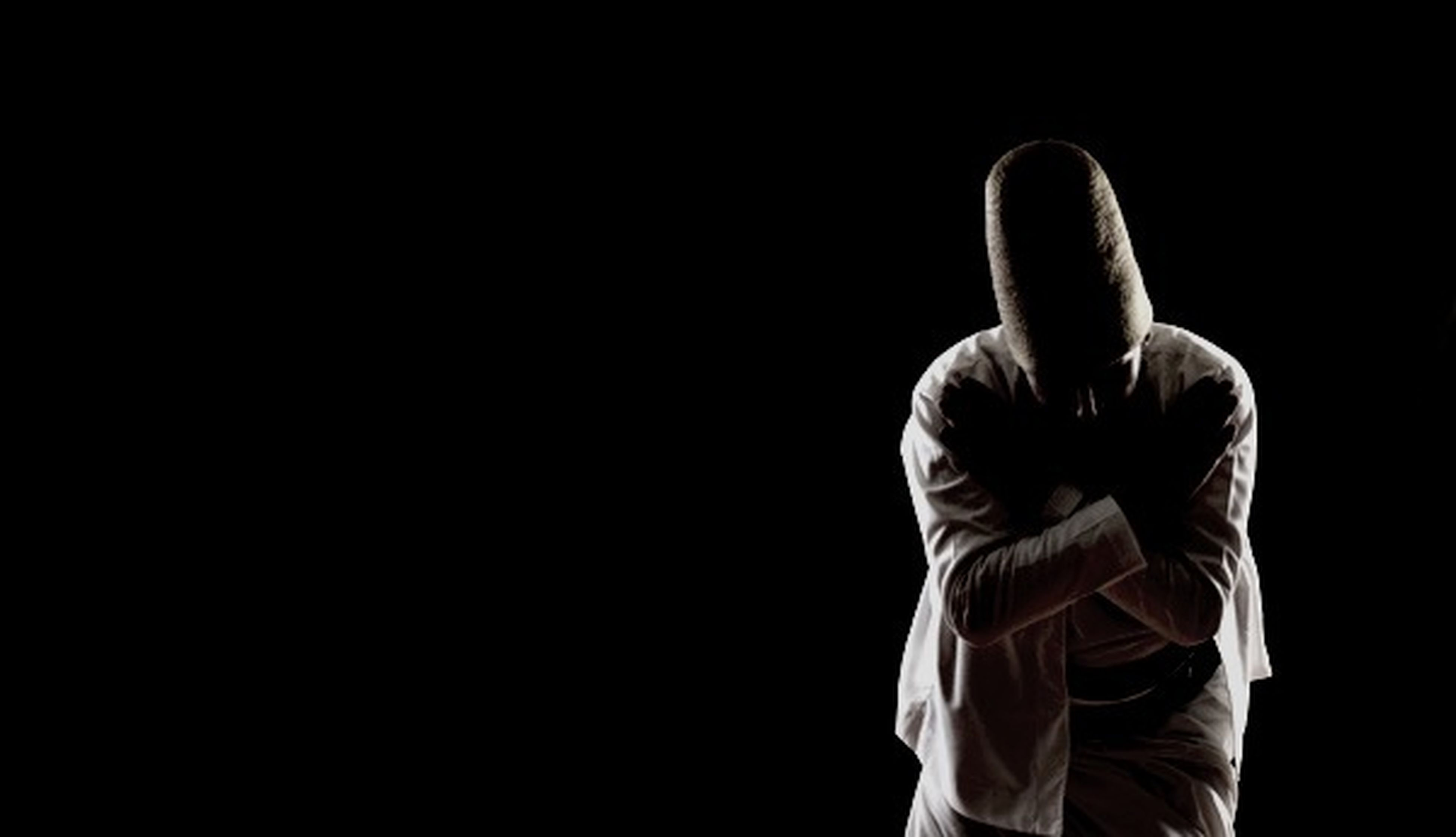 studio shot, copy space, black background, lifestyles, men, leisure activity, standing, night, person, dark, cut out, side view, close-up, clear sky, holding, unrecognizable person, part of