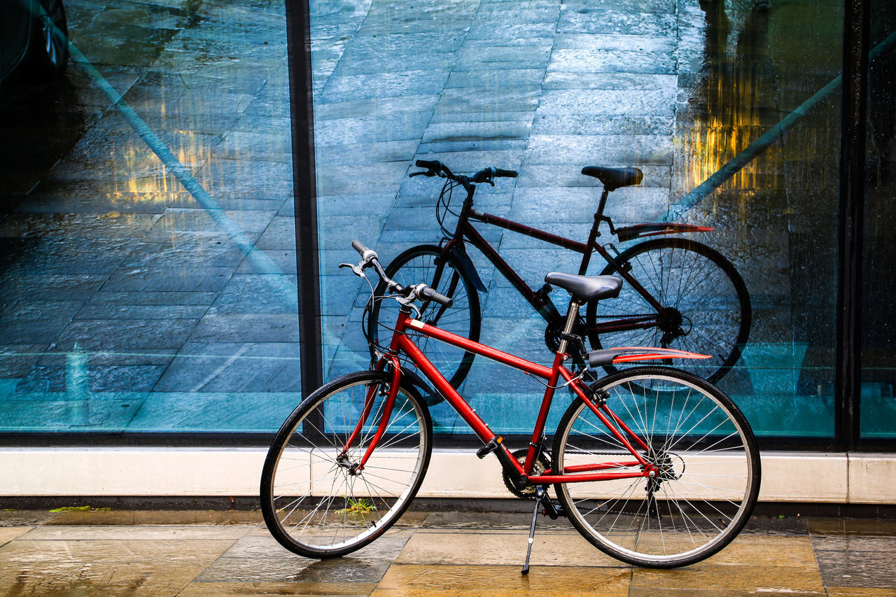 After Rain After The Rain Bicycle Bicycle Rack Check This Out City Day EyeEm Gallery EyeEmNewHere First Eyeem Photo Land Vehicle Mode Of Transport No People Outdoors Red Reflection On Glass Stationary Transportation Water Place Of Heart The Street Photographer - 2017 EyeEm Awards