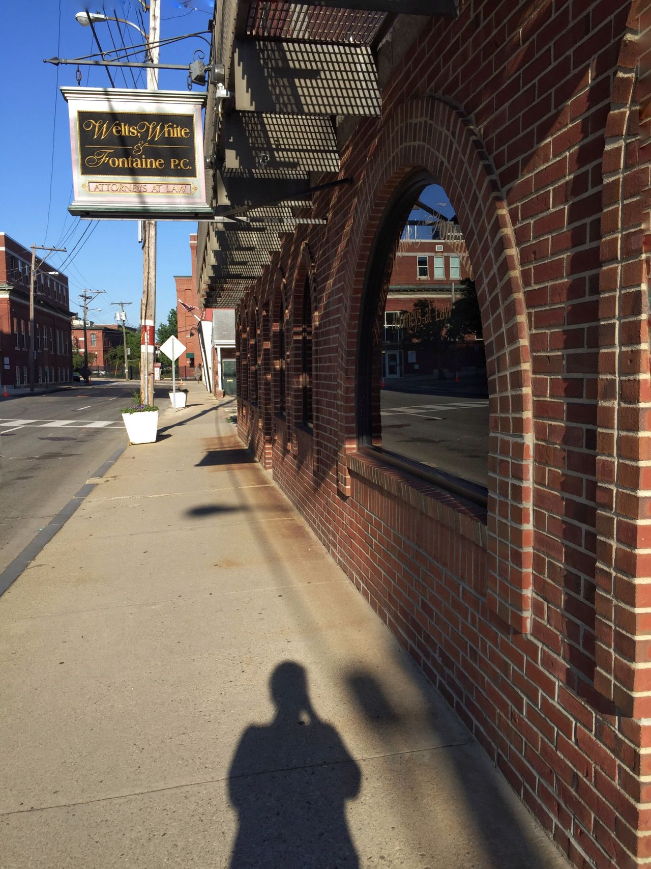 The reelection, the arched windows, and the photographer. Streetphotography Windows Arched Windows Brick Building Reflection Shadow IPhoneography Nashua Taking Photos Morning Walk