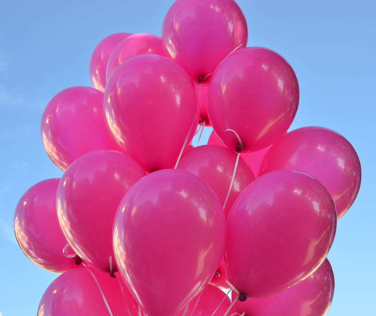 Low Angle View Of Pink Balloons Against Clear Sky