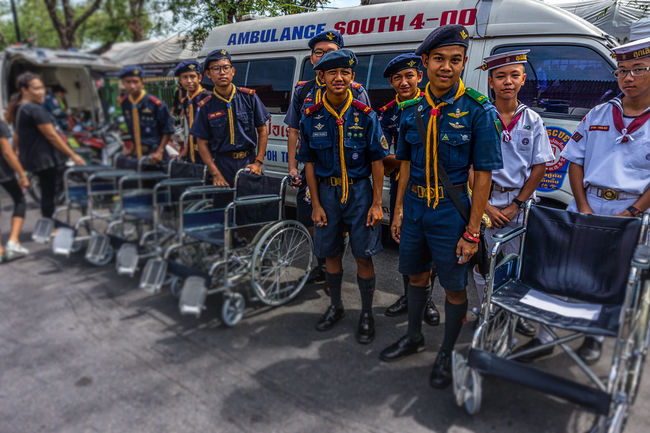Boy scouts ready to assist people with wheelchairs to go to the Grand Palace and pay respects to the late King Bhumipol Adulyadej. Bangkok Day Friendship Full Length Horizontal King Bhumipol Adulyadet Outdoors People Person Scouts Thailand Wheelchair Wheelchairs Young Adult