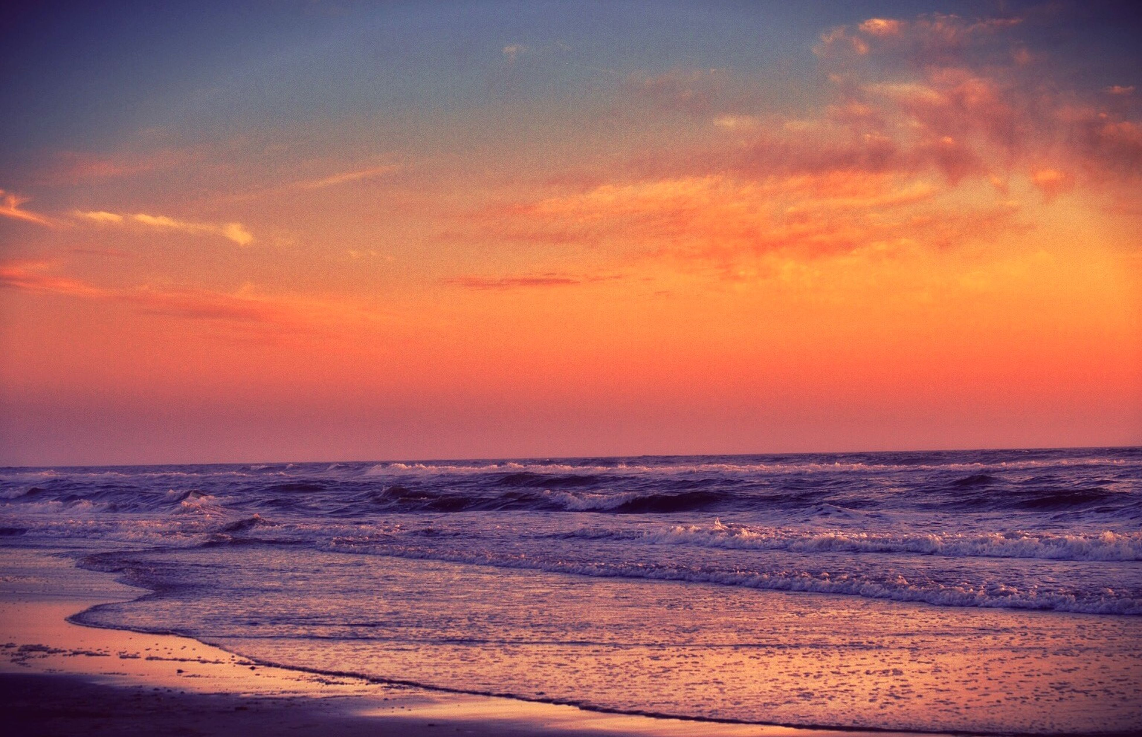 sunset, sea, horizon over water, orange color, beach, scenics, water, tranquil scene, beauty in nature, tranquility, shore, sky, idyllic, nature, wave, sand, sun, remote, outdoors, seascape