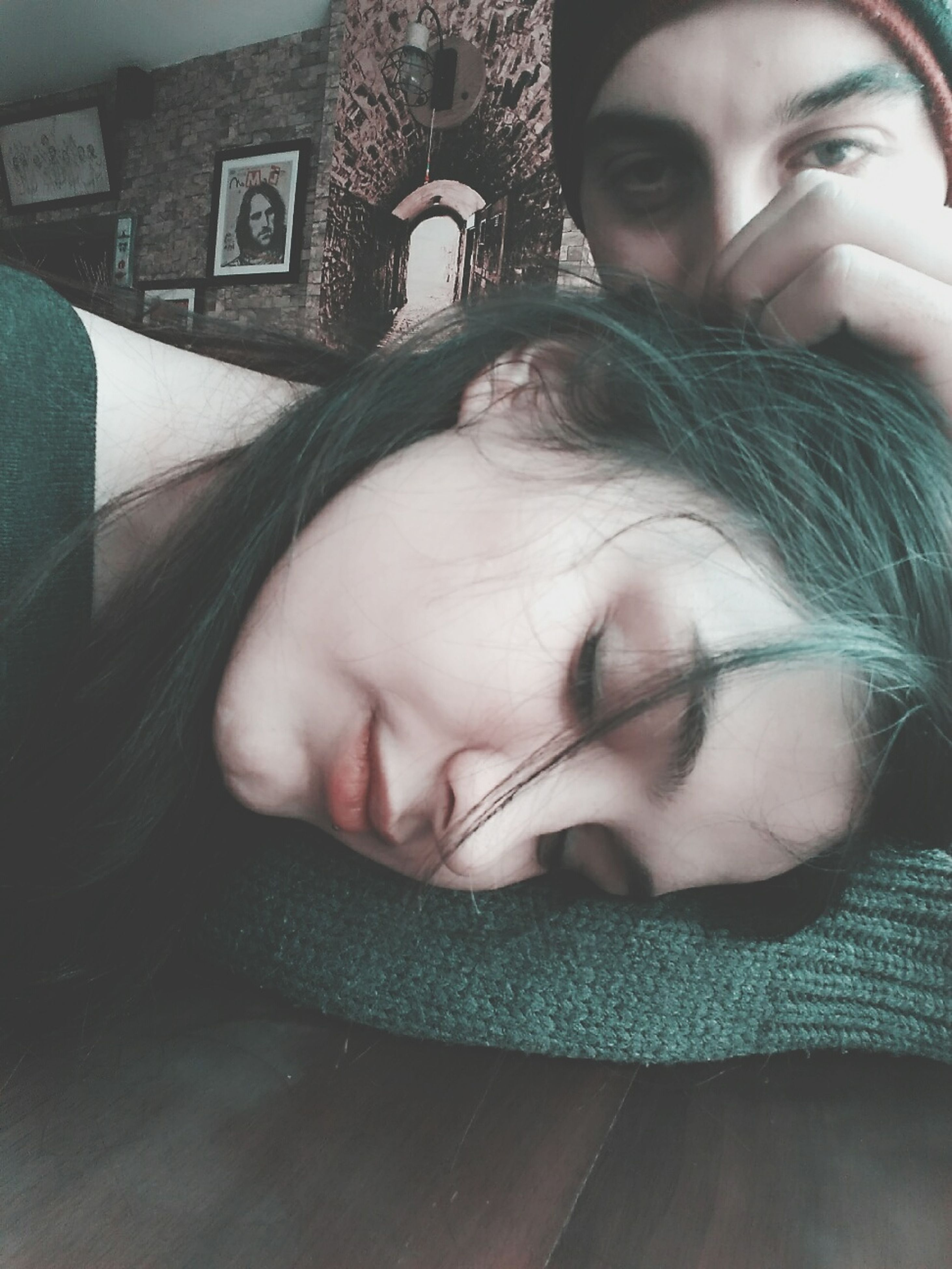 real people, indoors, young women, young adult, lifestyles, sleeping, front view, two people, leisure activity, home interior, headshot, looking at camera, childhood, human face, togetherness, close-up, day