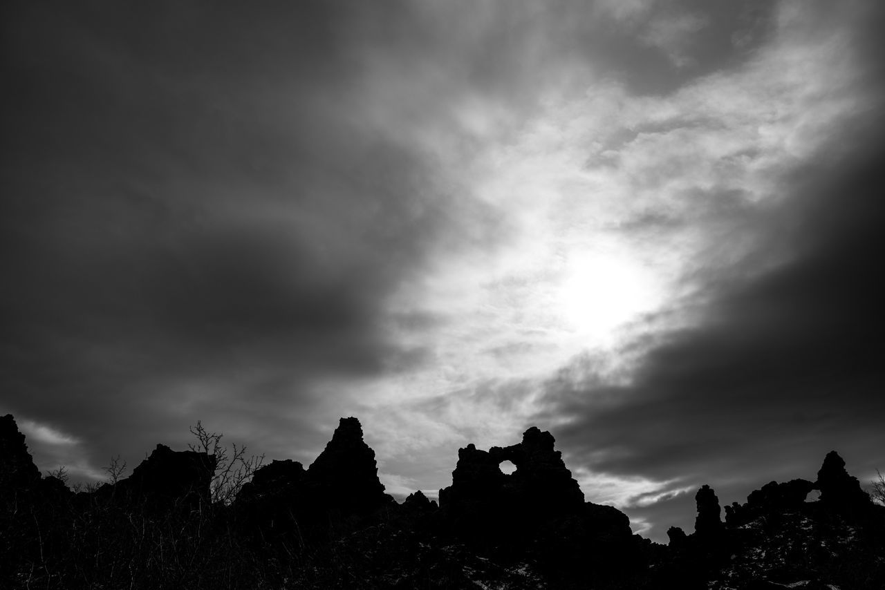 Dark Fortress. Sky Nature Cloud - Sky Scenics Silhouette Beauty In Nature Low Angle View Outdoors Iceland Memories Iceland_collection Iceland Iceland Trip Myvatn Dimmuborgir Ruins Silhouette Dark Darkness And Light Darkness Travel Destinations Roadtrip Traveling Black And White Black & White Travel Photography