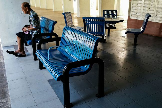 Samsung Galaxy Note 4 Streetphotography Street Photography Streetphoto_color People Old Man Smoking Void Deck Benches Up Close Street Photography Street Life Everybodystreet Housing Estate Residential  Colour Of Life