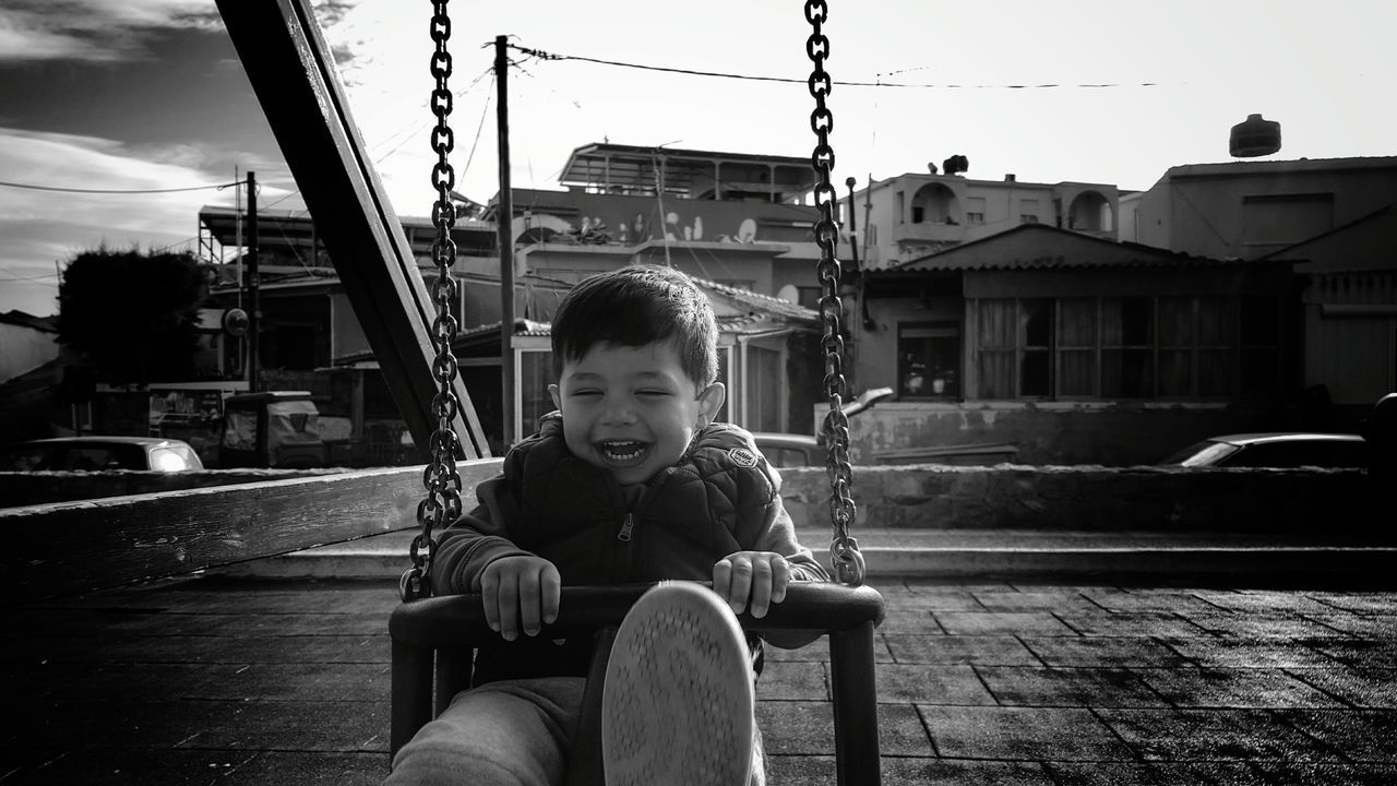 The Portraitist - 2016 EyeEm Awards Little Boy My Son Having Fun Loughing Swinging Enjoying Life Black&white Children Photography Black & White Kidsphotography Childsplay Playground From My Point Of View Blackandwhite Photography Childhood Child Boy Childrenphoto Black And White Found On The Roll