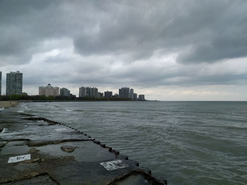 Lake Michigan by Foster beach. Urban Skyline Cityscape Cloud - Sky City Outdoors City Life Sky Water Storm Cloud No People Lake Michigan Lakeside Dreary Weather  Rainyweather Beautiful Weather Photography City