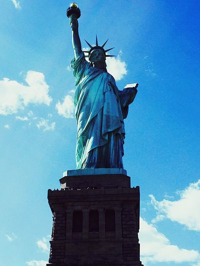 Statue Of Liberty Statue Female Likeness Human Representation Sculpture Travel Destinations Cloud - Sky Low Angle View Art And Craft Monument Freedom Sky Day Outdoors Architecture Travel No People Crown NYC Photography The Portraitist - 2017 EyeEm Awards