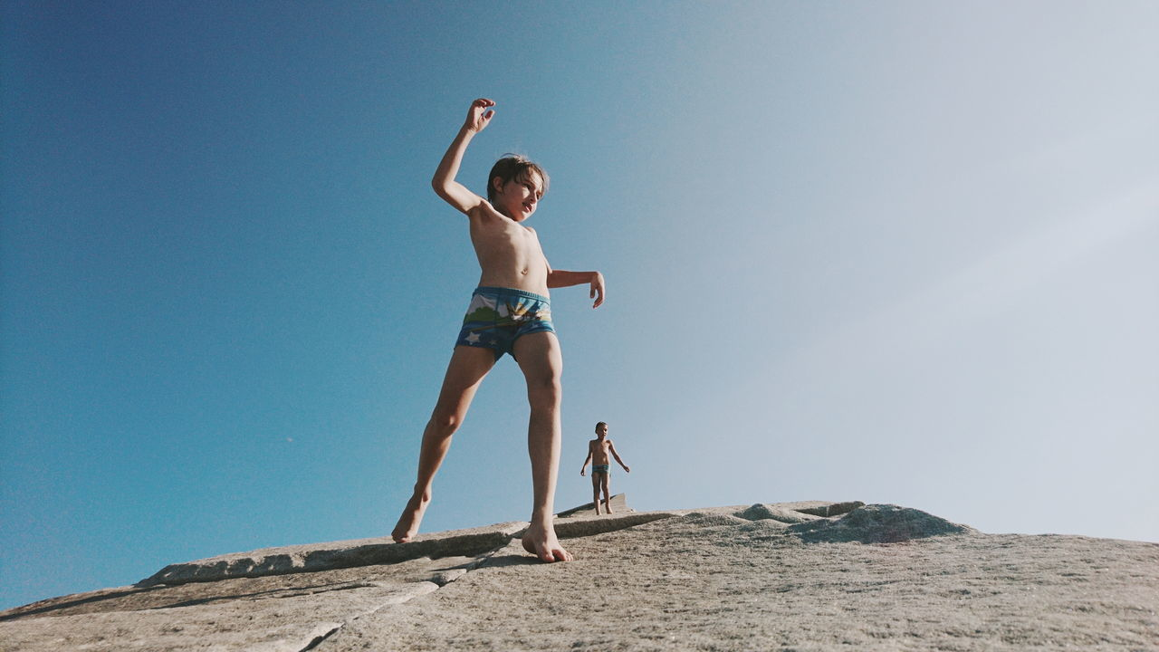 Full Length Arms Raised Day Outdoors Childhood Low Angle View Skill  People Children Only Carefree Shirtless Standing Concentration Blue Sky Boys Child Two People Adventure Young Adult EyeEm EyeEm Best Shots EyeEm Gallery Live For The Story