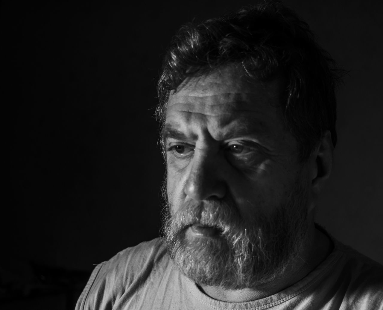 Beautiful stock photos of traurig,  54-59 Years,  Beard,  Black Background,  Casual Clothing