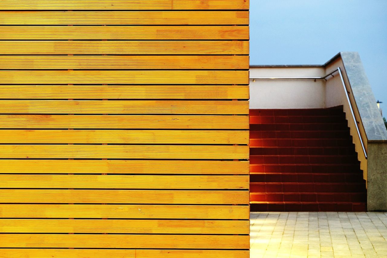 Geometry Shapes Pattern Wood Wooden Wall Fujifilm Structure Street Photography Geometric Shapes Shapes And Lines Lines Stairs Warm Colors Minimal Minimalism Design Exterior Design Check This Out Showcase July Neon Life Tbilisi The Architect - 2017 EyeEm Awards Embrace Urban Life BYOPaper! Let's Go. Together.