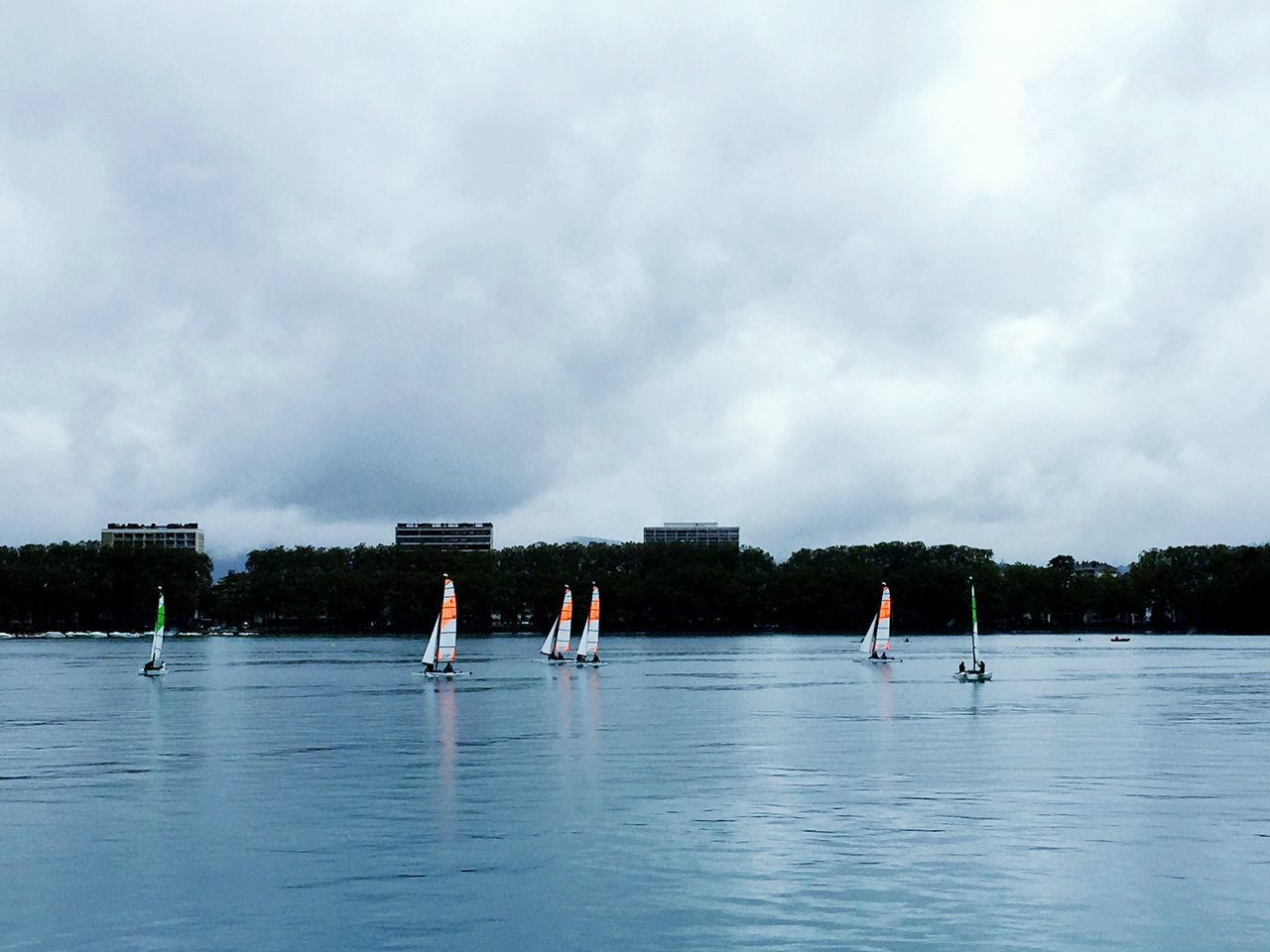 water, cloud - sky, real people, waterfront, sky, nature, sport, outdoors, day, beauty in nature, leisure activity, lifestyles, scenics, tree, sea, men, paddleboarding, people
