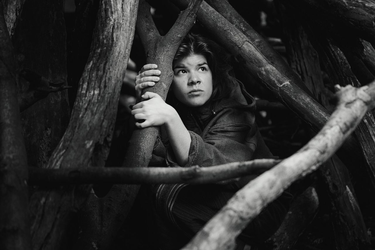 ~ Afraid of Humanity 🌿~The Portraitist - 2017 EyeEm Awards Portrait One Person Outdoors Day Child Children Only Childhood Tree Tree Trunk People Black & White Light And Shadow Monochrome Film Noir Style Human Face Getting Inspired Looking At Camera Forest Wilderness Canonphotography Live For The Story Real PeopleNature Lifestyles