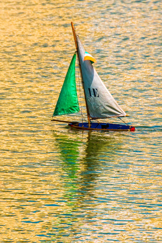 Close-up Day Lake Nature Nautical Vessel No People Outdoors Sailing Toy Boat Toy Boat On Pond. Tranquil Scene Tranquility Water