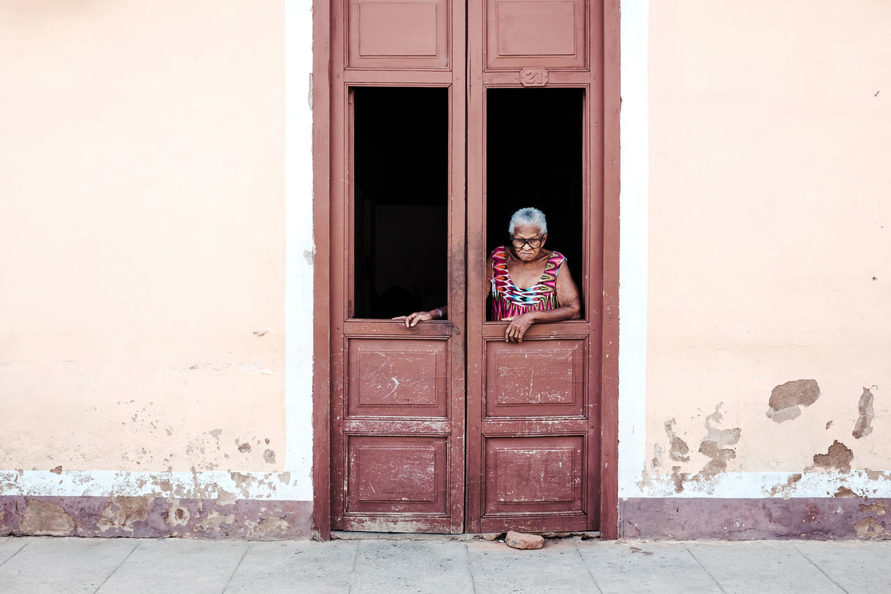 Que quiere? Architecture Building Exterior Built Structure Cuba Day Door Doorway Entrance Human Representation One Person Open Door Outdoors People Real People Standing Streetphotography Trinidad Window Young Adult