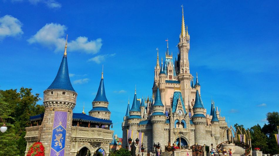Travel Destinations Sky Blue Religion Tree Architecture Building Exterior City Place Of Worship Tower Outdoors Cultures No People Built Structure Day Clock Tower Clock Cityscape Christmas Tree Disney DisneyWorld Disney World Cinderella Castle Cinderella