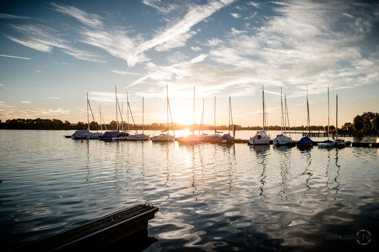 An evening at the lake. Nautical Vessel Water Boat Sun Cloud Reflection Sky Harbor Sailboat Scenics Nature Taking Photos Hanging Out Evening Sky Evening Light Sunshine