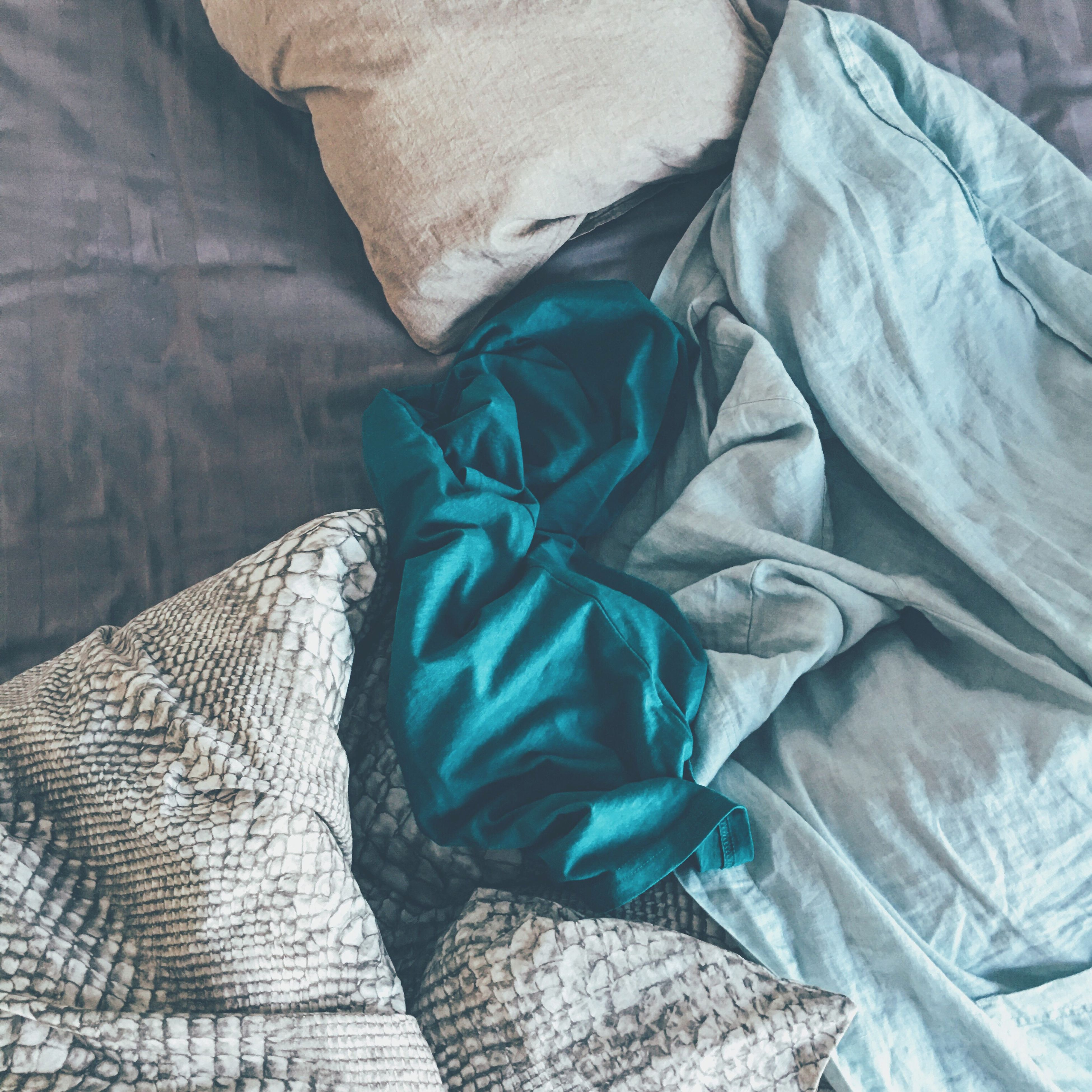 indoors, fabric, textile, blue, high angle view, bed, pattern, jeans, relaxation, close-up, sheet, day, one person, low section, blanket, clothing, comfortable, pillow, sunlight