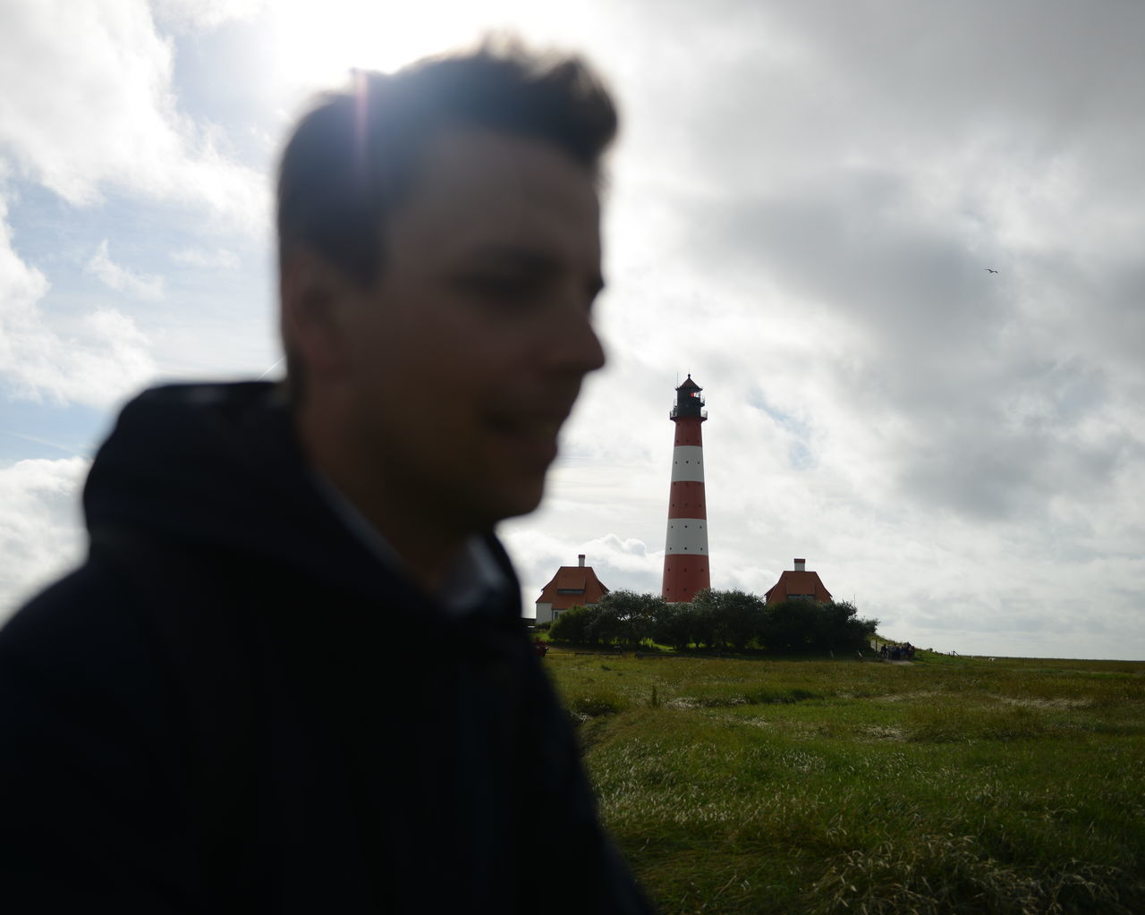 sky, architecture, cloud - sky, lighthouse, built structure, grass, outdoors, day, building exterior, one person, men, nature, people