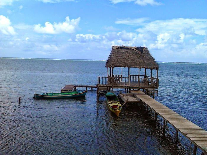 First Eyeem Photo Islands Roatan, Honduras Sea Side Cabin Little Boat Manned By One Person Miles Away