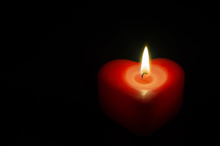 Wax red heart burn alone in the dark Burning Christmas Dark Faith Feeling Flame Love Romance Romantic Valentine's Day  Backgrounds Burning Candle Candlelight Flame Heart Shape Illuminated Isolated On Black Night Passion Praying Red Simplicity Tranquil Scene Wish