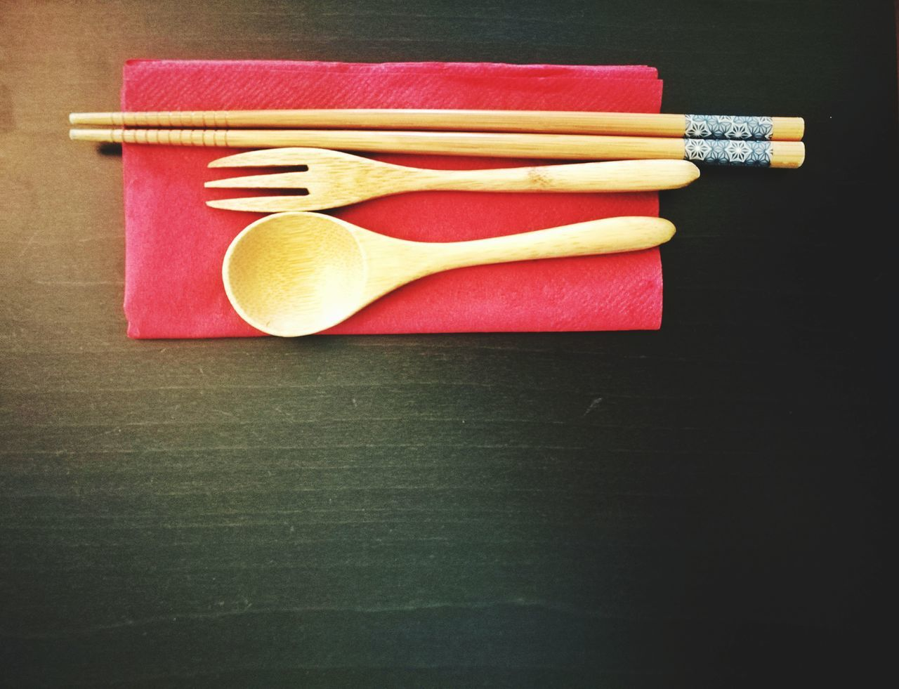 Directly Above Shot Of Chopsticks By Fork And Spoon On Place Mat
