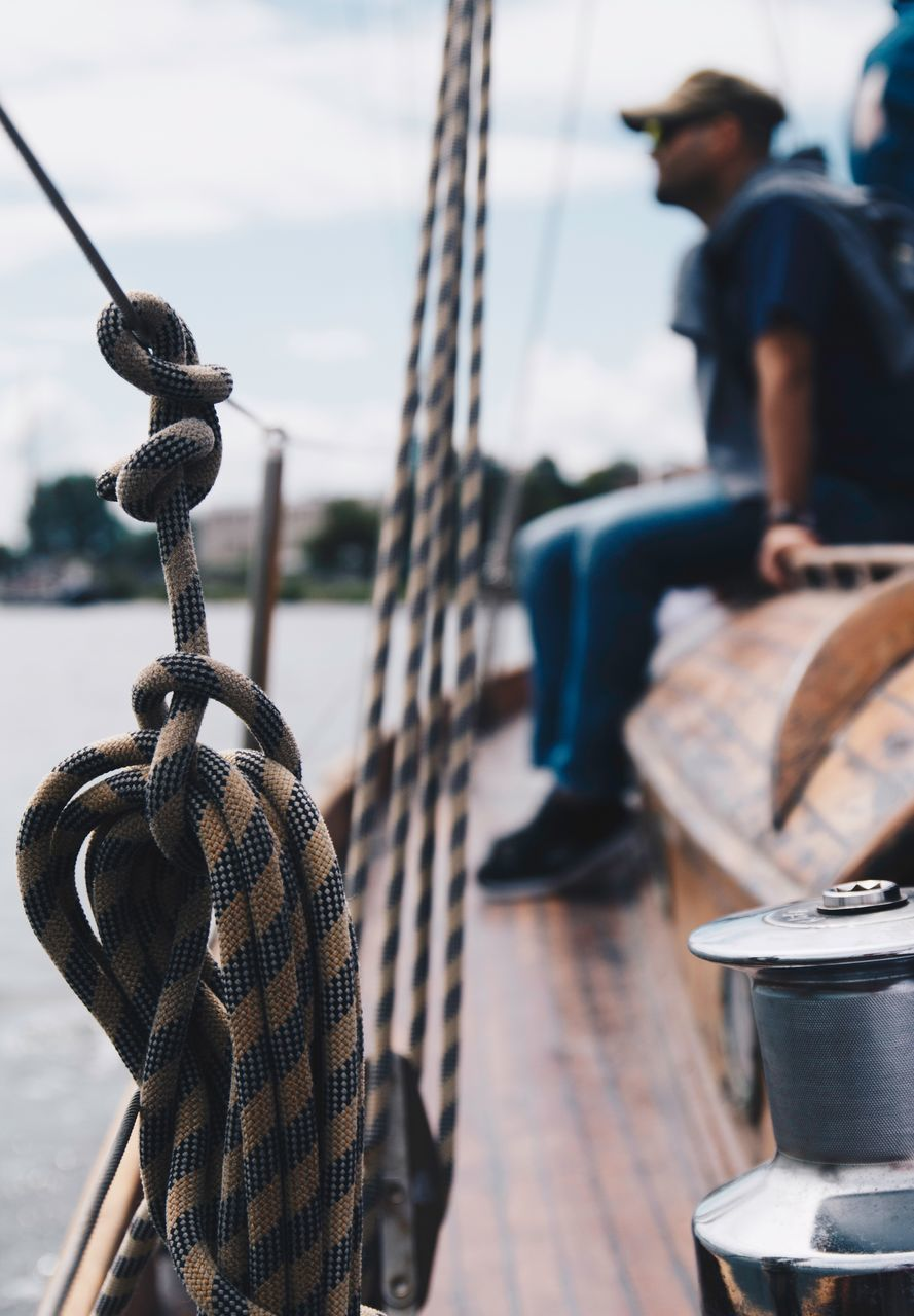 rope, focus on foreground, strength, tied up, outdoors, day, cleat, no people, close-up, nautical vessel, sky