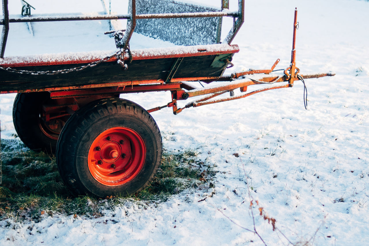 Close-up Cold Cold Temperature Day Grass Metal Nature No People Outdoors Red Rural Rural Scene Snow Tire Trailer Winter