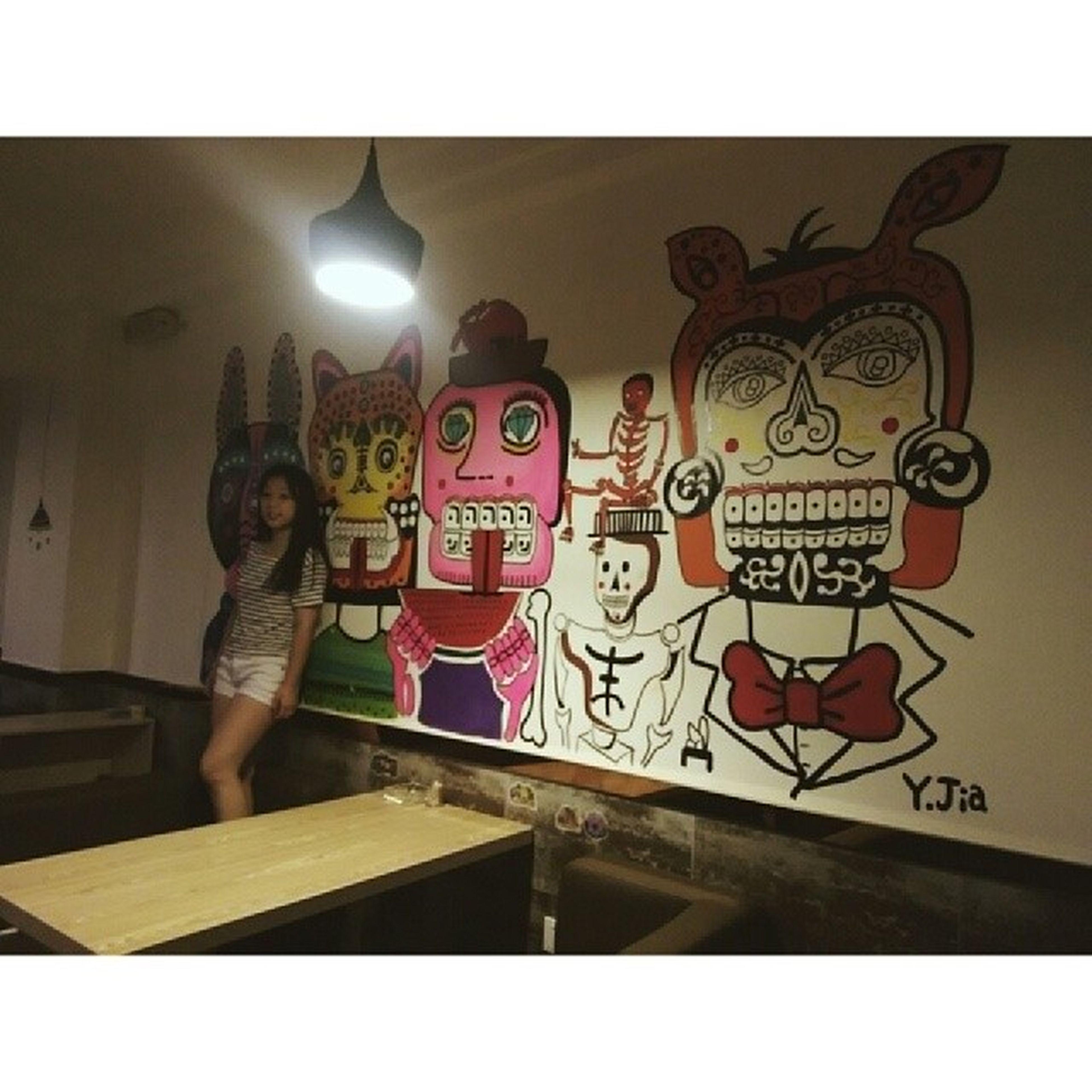 transfer print, auto post production filter, indoors, art, creativity, art and craft, human representation, wall - building feature, lifestyles, built structure, leisure activity, architecture, graffiti, illuminated, communication, animal representation