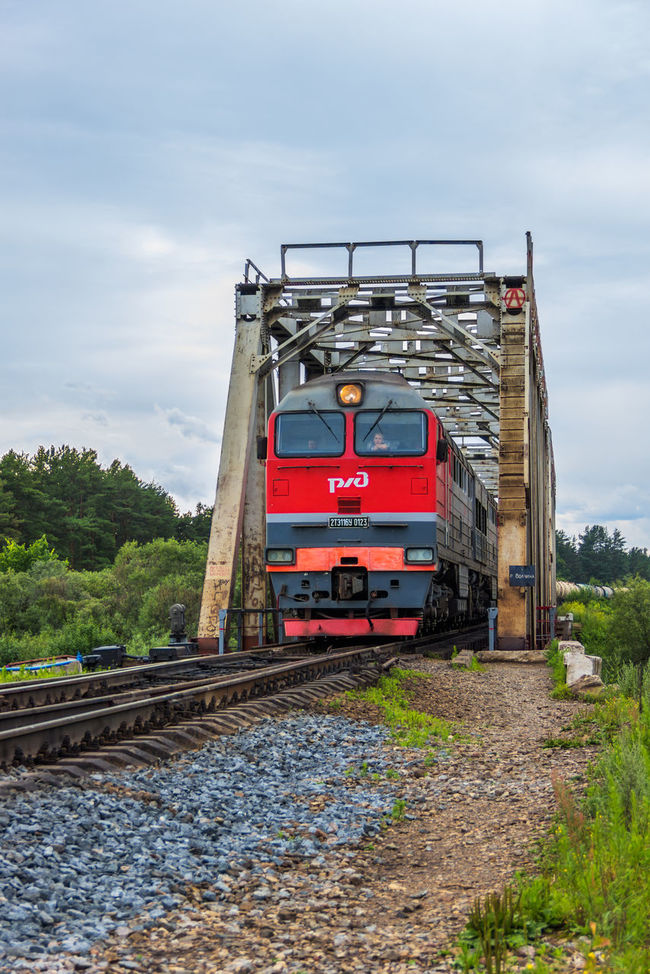 The train leaves from the railway bridge Bridge Maksatiha Maksatikha Mode Of Transport Nature Outdoors Railroad Railway Bridge Red Russia Semi-truck Sleepers Train Train - Vehicle Transportation