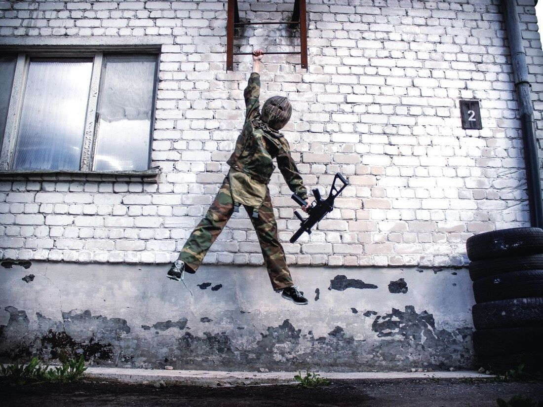 Jumping Mid-air Motion Full Length Day Architecture Army Soldier Real People Outdoors Army Military Men Military Uniform Built Structure One Person Building Exterior Camouflage Clothing People Monster Gun G36