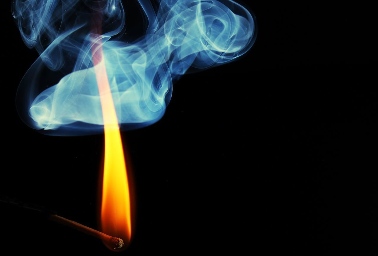 burning, black background, flame, heat - temperature, studio shot, smoke - physical structure, matchstick, no people, close-up, yellow, indoors