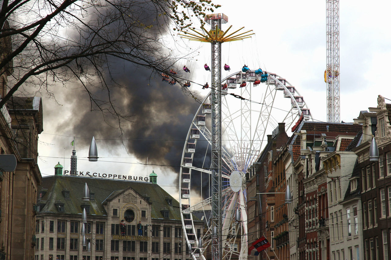 look, something's on fire Amsterdam Amusement Park Amusement Ride Architecture Building City On Fire Outdoors Sky