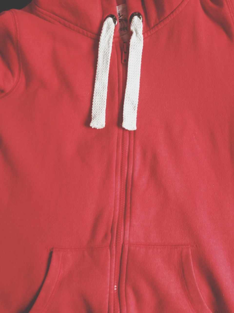 Directly Above Shot Of Red Hooded Shirt