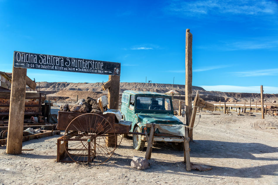 Entrance to the UNESCO World Heritage ghost town of Humberstone, Chile Architecture Building Chile Dust Factory Heritage Humberstone Industrial Iquique Landscape Nitre No People Old Outdoors Salitrera Saltpeter Saltpetre Sand Santa Laura Site Sunny Town UNESCO World Heritage Site Village Works