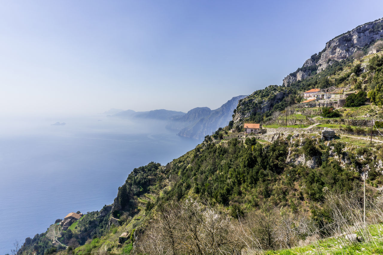 We decided to make this really nice hike in Italy called the path of god Architecture Beauty In Nature Building Exterior Built Structure Clear Sky Cliff Day Landscape Mountain Mountain Range Nature No People Outdoors Scenics Sky Tranquil Scene Tranquility Tree