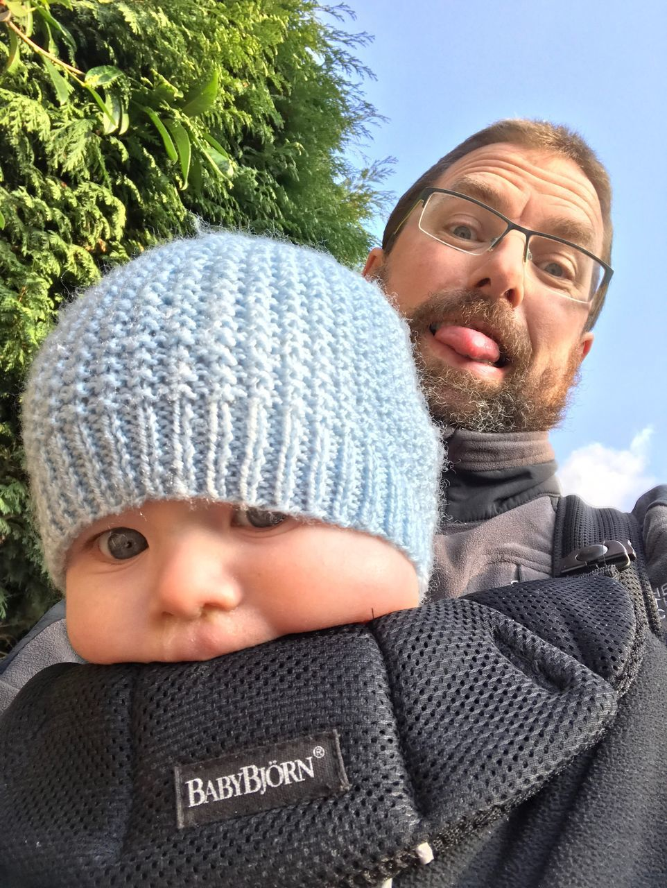 baby, front view, babyhood, looking at camera, portrait, headshot, childhood, real people, day, lifestyles, close-up, one person, warm clothing, eyeglasses, outdoors, people