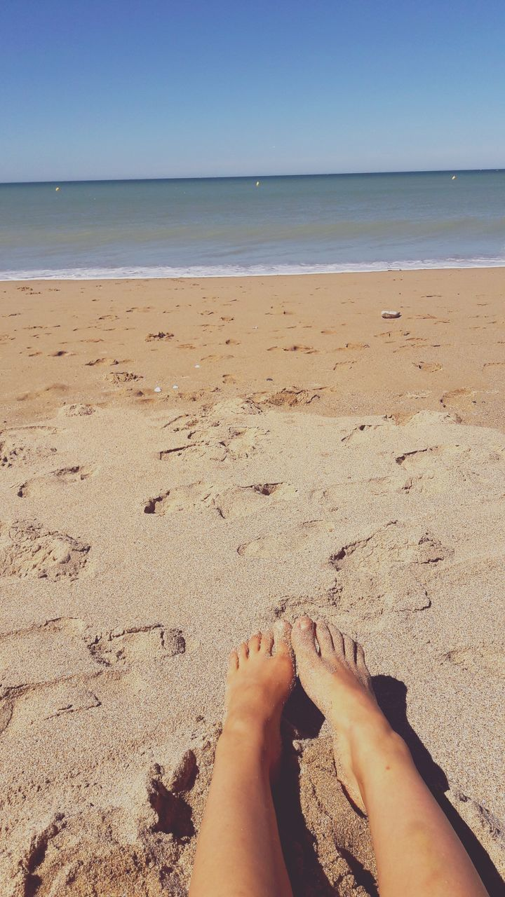 beach, sand, barefoot, sea, low section, real people, shore, human leg, one person, human foot, human body part, personal perspective, horizon over water, water, nature, day, outdoors, beauty in nature, leisure activity, sandy beach, tranquility, vacations, scenics, lifestyles, sunlight, women, sky, close-up