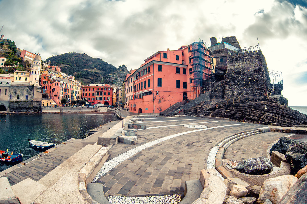 View of Vernazza. Vernazza is a town and comune located in the province of La Spezia, Liguria, northwestern Italy. Ancient Architecture Breakwater Cinque Terre Cloudy Sky Coastal Europe Famous Place Fishing Village Harbor Italian Riviera Italy La Spezia Landmark Landscape Liguria,Italy Mediterranean Sea Mountain Nature Nobody Pier Scenery Tourist Resort Town Vernazza Village